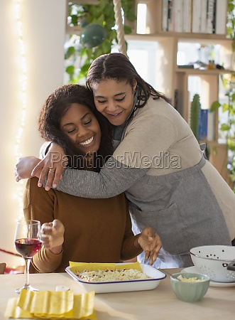 affectionate mother and daughter hugging and