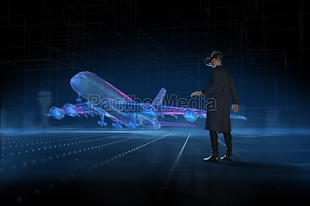 man with vr headset watching holographic