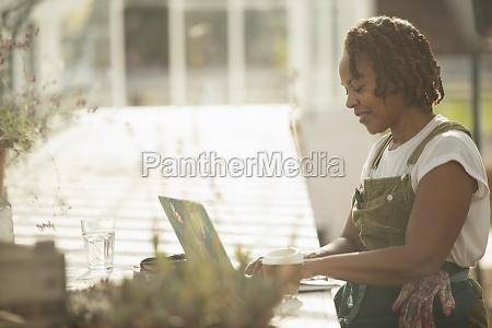 female garden center owner working at