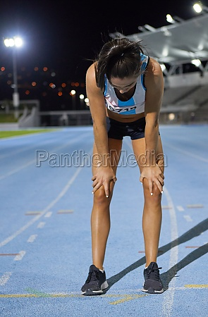 exhausted female track and field athlete