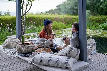couple enjoying wine on luxury patio