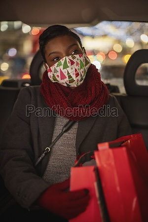 young woman in christmas face mask