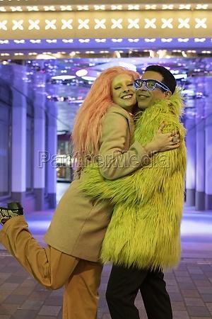 portrait happy stylish couple hugging under