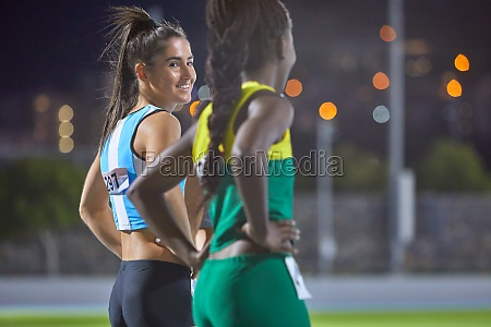 happy female track and field athletes
