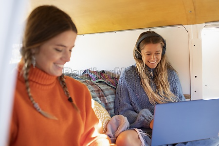 young women friends using laptop in