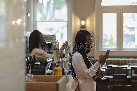 young woman using smart phone and