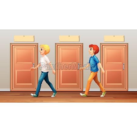 two men walking along the corridor