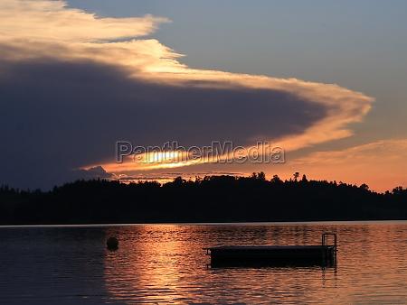 ufo shaped cloud with a sun