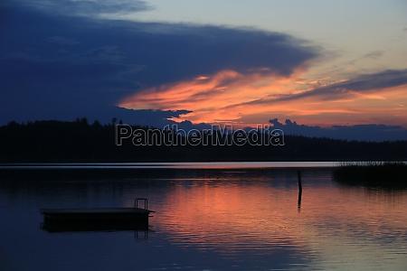 dramatic sky over lake pfaeffikon zurich