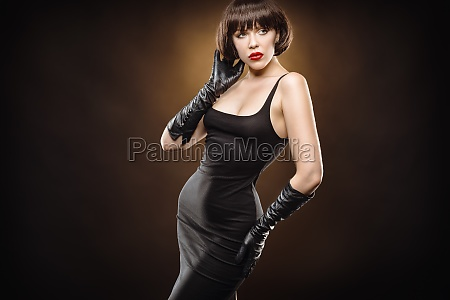 young beauty with black gloves