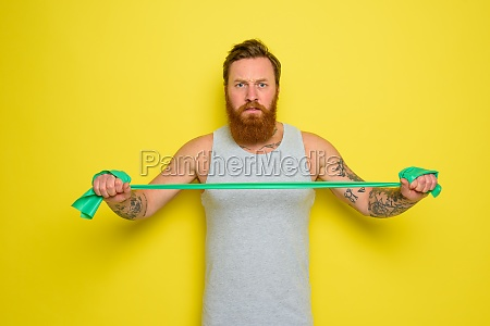 man with beard and tattoos trains