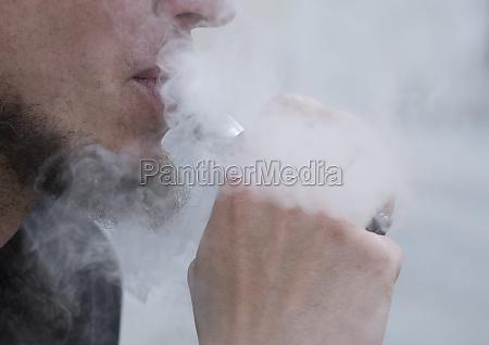 smoking an e cigarette or electronic