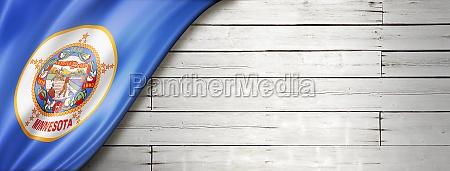 minnesota flag on white wood wall