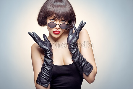 young beauty poses with gloves and