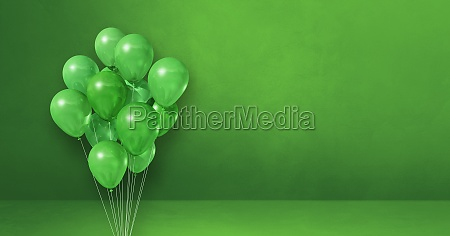 balloons bunch on a green wall