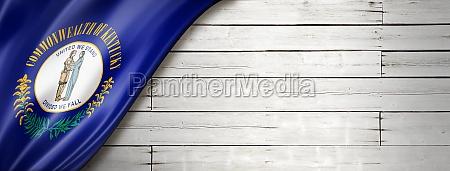 kentucky flag on white wood wall