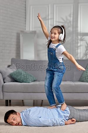 happy little child daughter doing massage