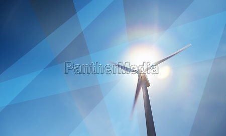 wind turbine against sky and sun