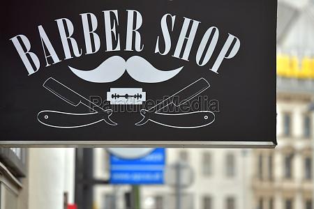 schild eines barber shops in wien