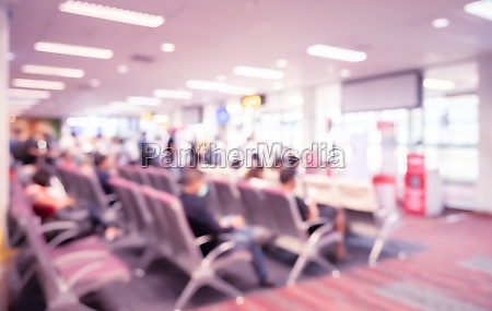 abstract blurred background of passengers waiting
