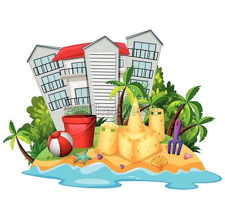summer theme with sandcastle on beach