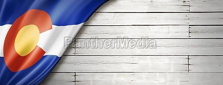 colorado flag on white wood wall
