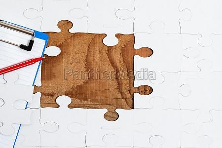 close up white jigsaw pattern puzzle