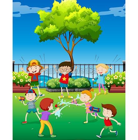children playing water gun in the