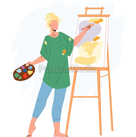 artist woman painting picture on canvas