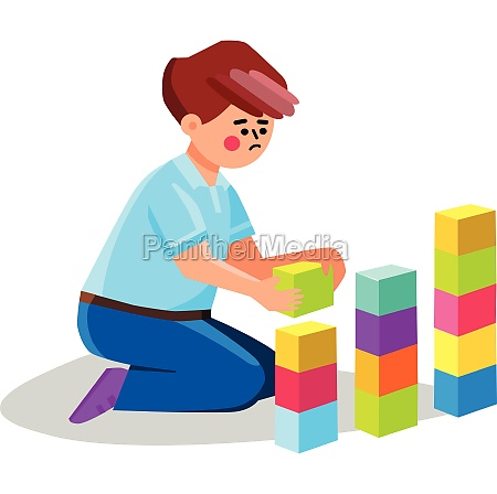autism child playing alone with cubes