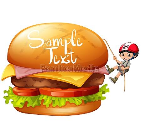 boy climbing cheeseburger alone