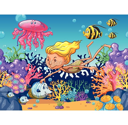 girl swimming with sea animals underwater