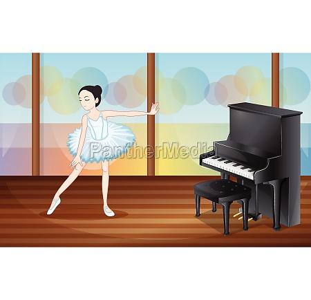 a ballet dancer near the piano