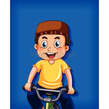 happy muslim boy riding bicycle
