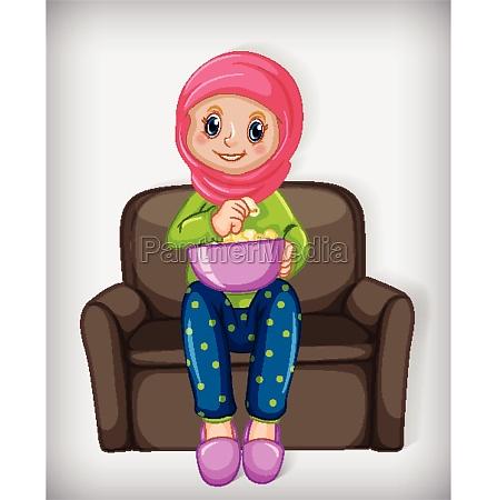 muslim girl eating popcorn