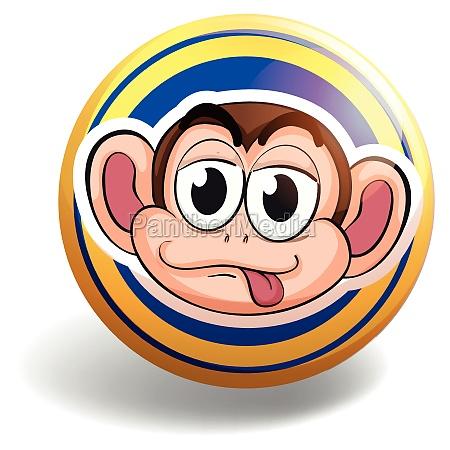 monkey face on round badge