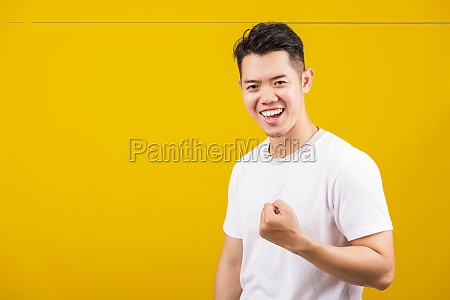 young man smiling positive shaking hands