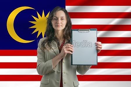 study in malaysia beautiful woman holding
