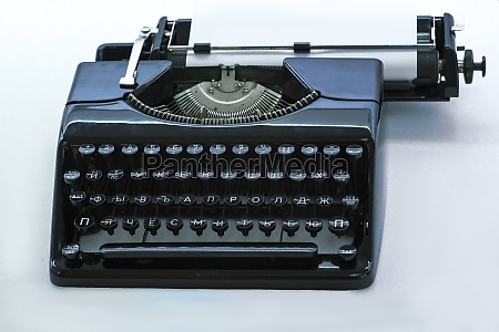 old vintage typewriter with a blank