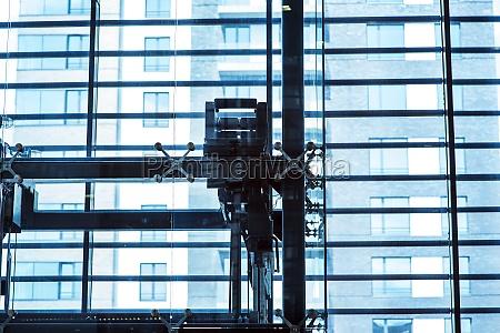 glass elevator businessman taking modern glass