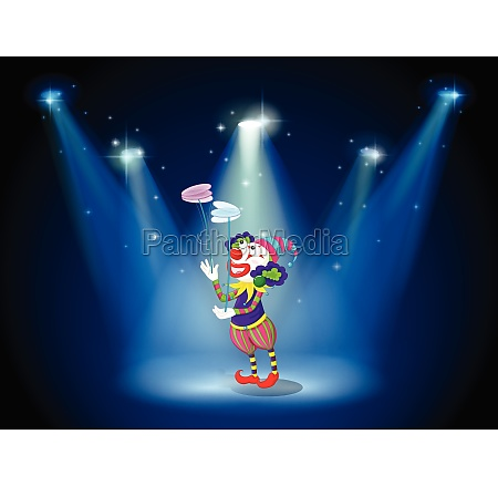 a clown performing on a stage