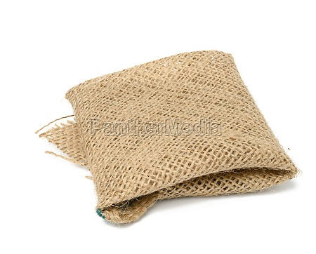 folded brown burlap fabric and ioled