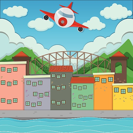 airplane flying over the town