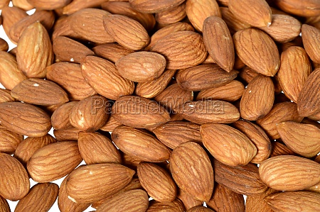 tasty almonds nuts isolated on white