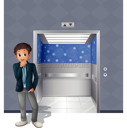 a boy standing outside the elevator
