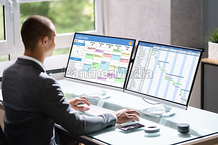 businessman appointment computer to check business
