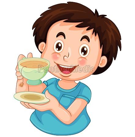 a boy drinking tea