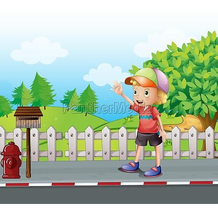 a young boy waving near the