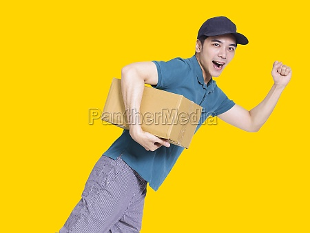 young delivery man run quickly and