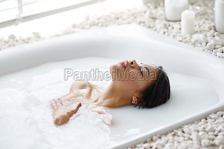 attractive woman relax skincare in bath